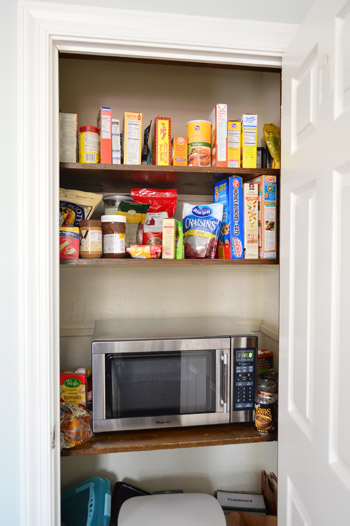 kitchen corner shelves pot hangers adding extra and a microwave to the pantry | young ...