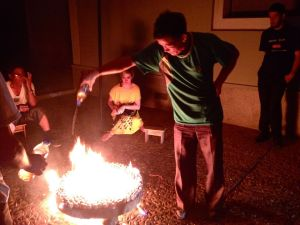 A man cooking 'petrol clams' at Rason.