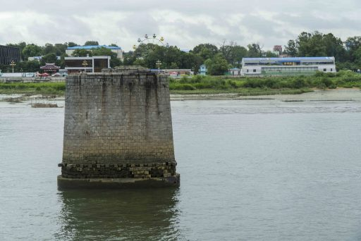 A Broken Bridge piling juts out of the water in the Yalu River.