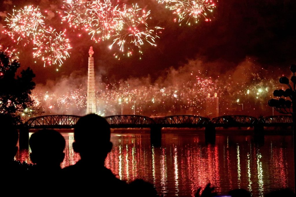 Fireworks about the Taedong river with a view of the Juche Tower