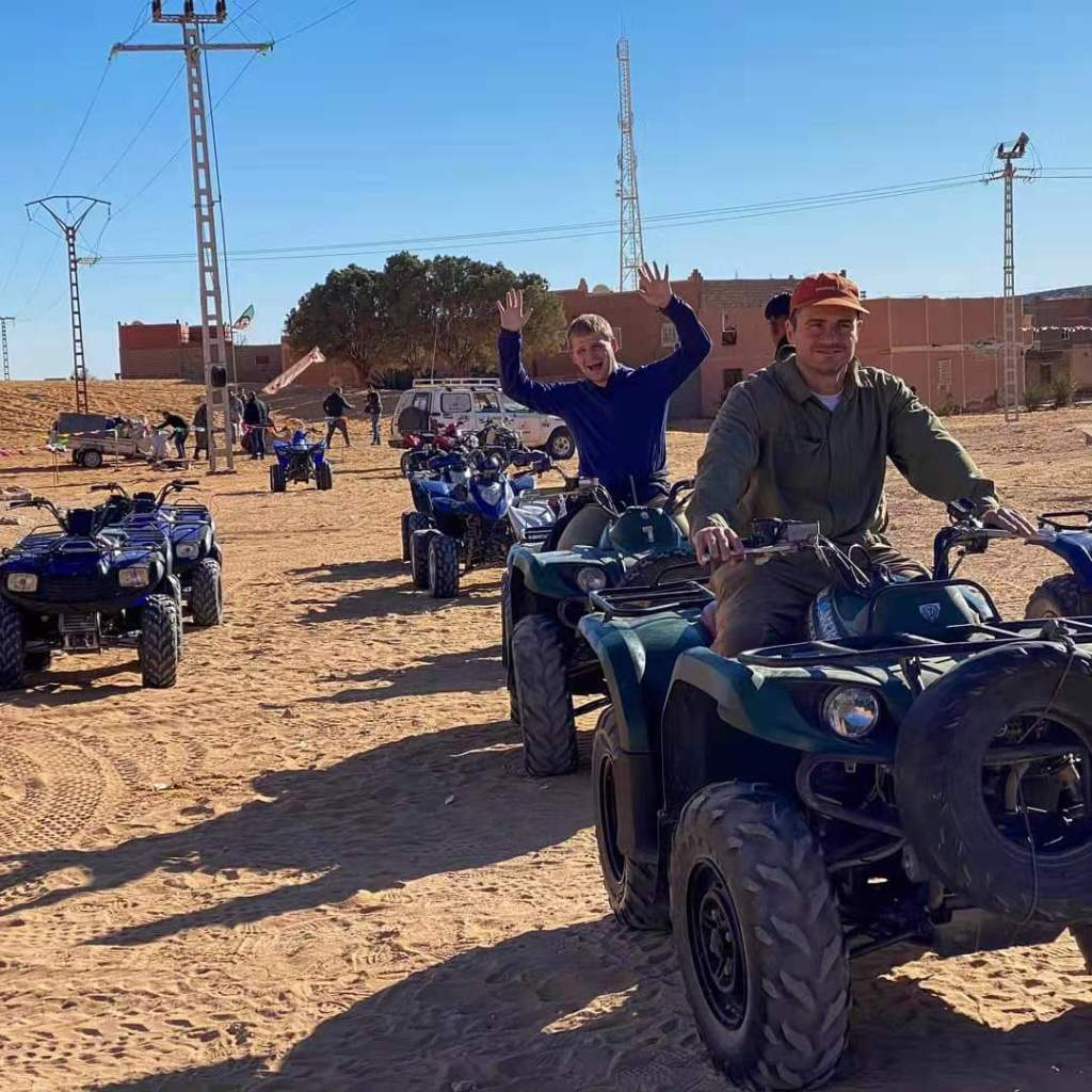 Our group riding quads ATM in the Algerian desert