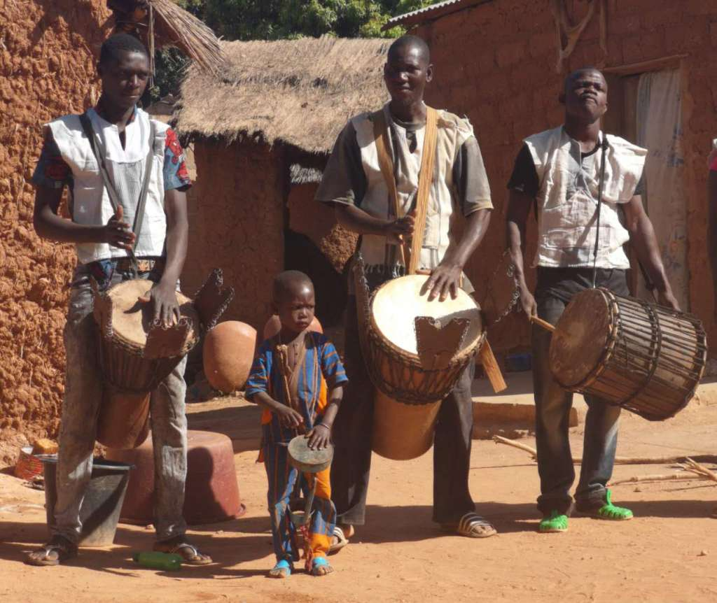 Drummers part of a pottery dance in Kawara, Burkina Faso
