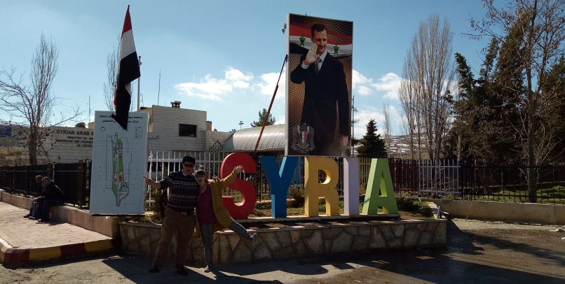 Taking a photo near the Syria sign in Damascus