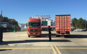 Trucks cross the Hunchun border crossing.  -- China-North Korea border