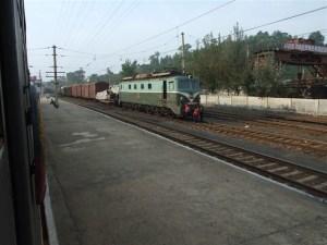 A train at Kimchaek Railway Station.