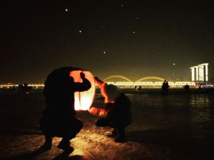Lighting lanterns along the river