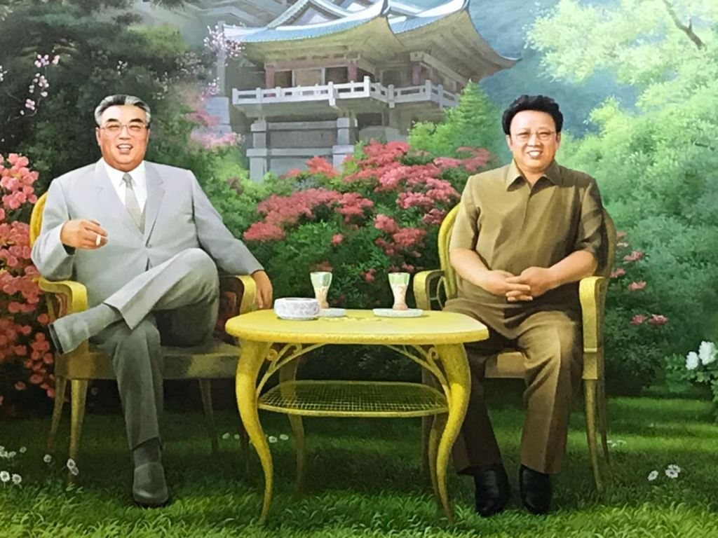 Kim Il-Sung and Kim Jong-Il. Key to answering what is Juche.