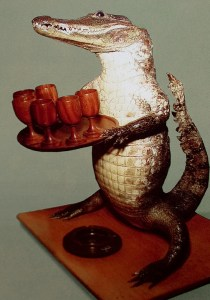 A stuffed crocodile holding a tray of drinks -- one of the more bizarre exhibits at the International Friendship Exhibition.