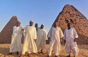 A group of Sudanese hanging out by Napata Sudan