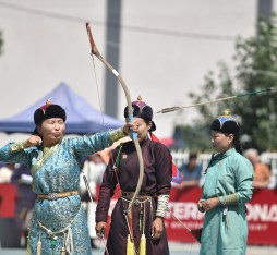 Mongolian archery: an archer looses an arrow at the Ulaanbaatar naadam.