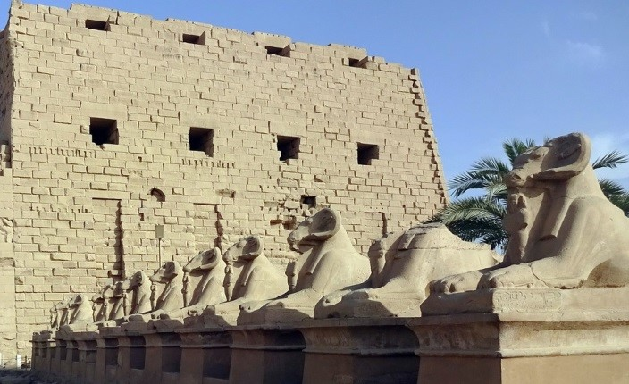 An array of stone rams guard the Karnak Temple.