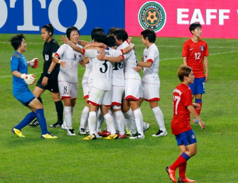 The North Korean women's squad celebrates their victory over South Korea.