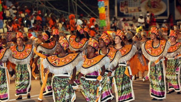 Angola Carnival dancers make their way through the streets in colourful costumes.