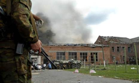 A Russian soldier stands outside Beslan school, North Ossetia, during the standoff with Islamic militants.