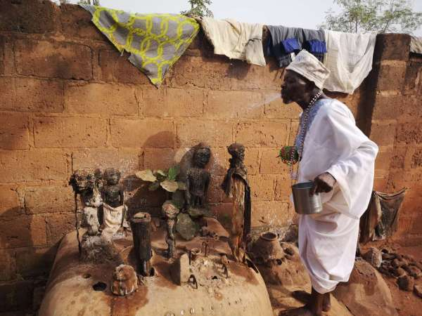 The voodoo priest of Abomey conduct a ceremony