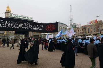 A procession taking place in front of Imam Husayn's Shrine, in Karbala