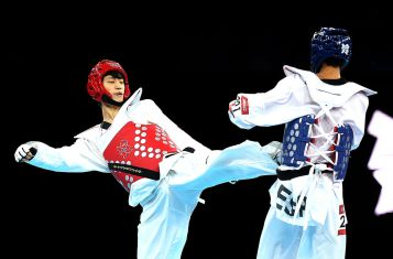 Two fighters practicing Taekwondo