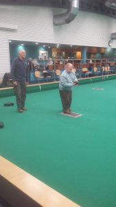 Michael from the OWLS Lads Lunch showing us all how it's done at the indoor bowls session