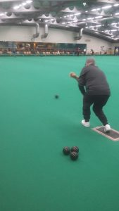 Michael from OWLS Lads Lunch trying indoor bowls for the first time