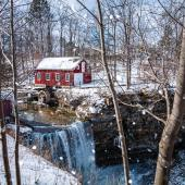 Red cabin on snowy river