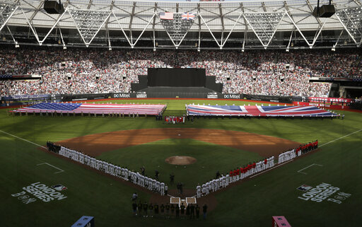 795c6da8e Boston Red Sox and New York Yankees players line up as flags are unfurled  before a baseball game, Saturday, June 29, 2019, in London.