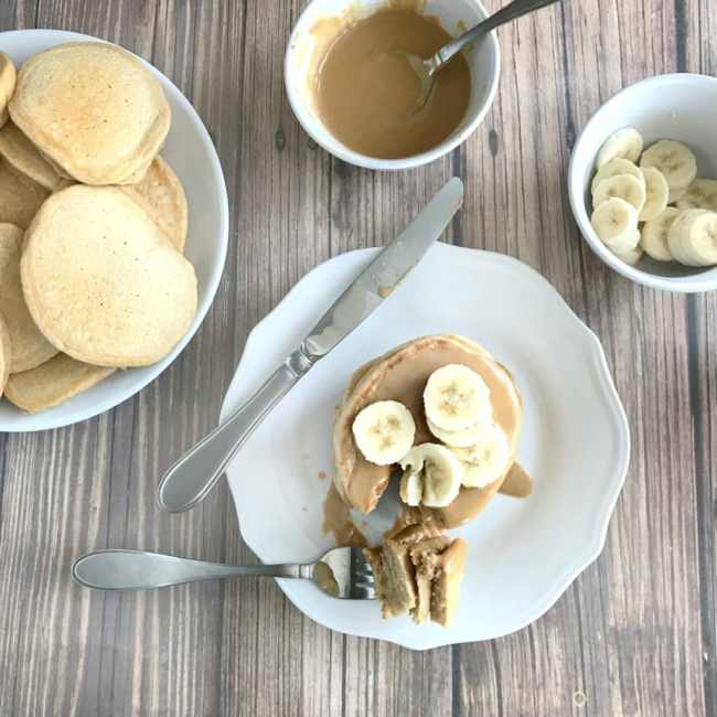 These Whole Wheat Peanut Butter Protein Pancakes satisfy your craving for comfort food (in a healthy way!) and keep you feeling full all morning long!   recipe via www.yourchoicenutrition.com