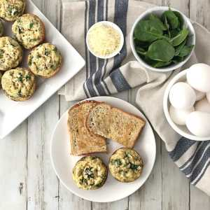 These Spinach Parmesan Egg Muffins are an easy, healthy breakfast you can make ahead and eat on-the-go! | Recipe via www.yourchoicenutrition.com