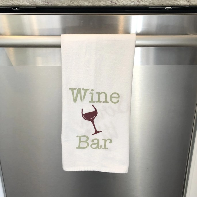 Towel with a picture of a wine glass and the phrase Wine Bar