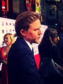 Upon arriving, Charlie Hunnam greeted fans first prior to meeting with the press.