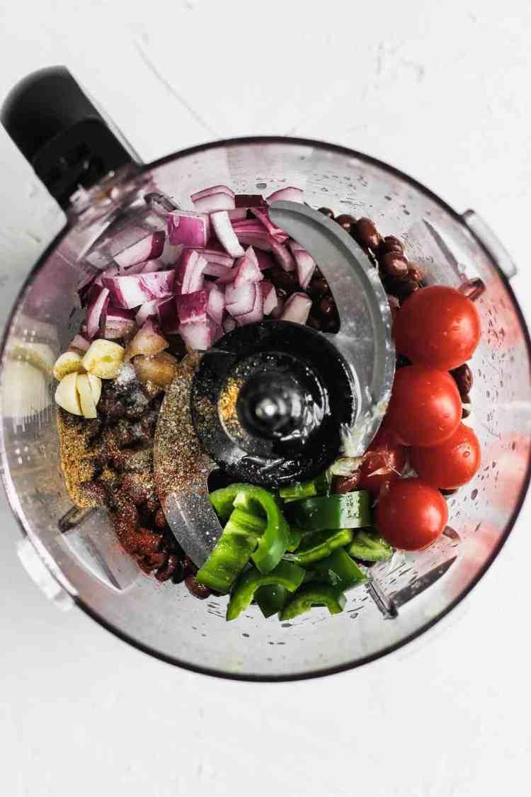 Ingredients for black bean dip in a food processor before blending.
