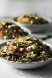 Close up of Mediterranean pasta in 3 white bowls.