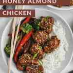 Air fryer almond chicken in honey soy sauce in 2 white bowls with a side bowl of sesame seeds.