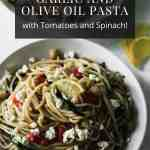 Mediterranean garlic and olive oil pasta with lemons on the side.
