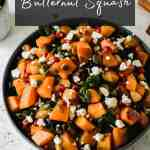 Roasted Butternut squash with apples and kale in a black serving bowl.