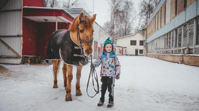 young boy with horse for hippotherapy