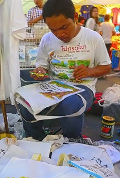 """Bags and shirts painted to order at """"Walking Street"""""""