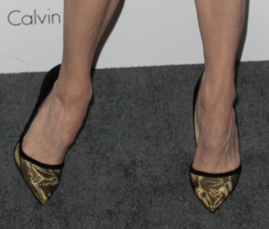 Renee Zellweger's feet in gold-detailed pumps from Christian Louboutin