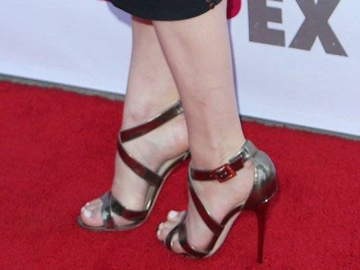 Alexandra Daddario showed off her hot feet in metallic silver shoes