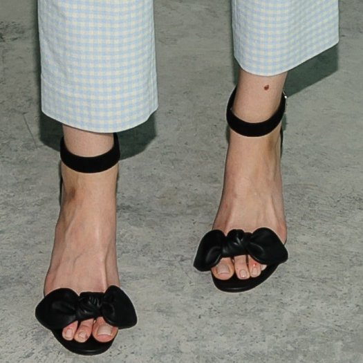 Brooklyn Decker shows off her feet in bow detail stiletto sandals from Alexander McQueen