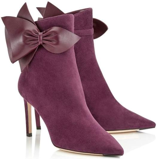 Crafted from purple suede, the Italian-made design zips up at the side and works an angular shape, with a slender heel and a neck that curves upwards slightly at the front