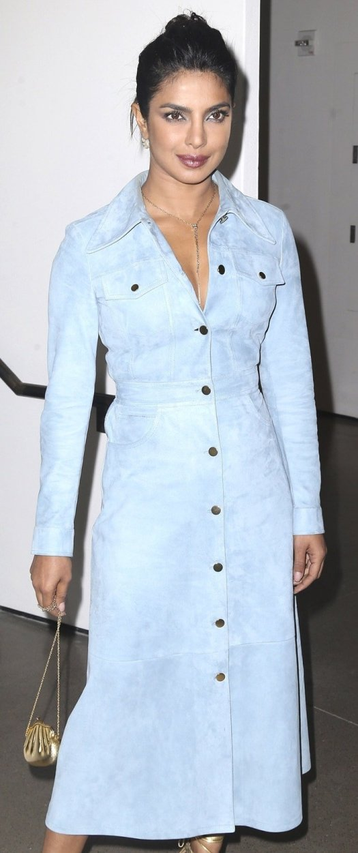 Priyanka Chopra wearing a chambray trench coat from Michael Kors