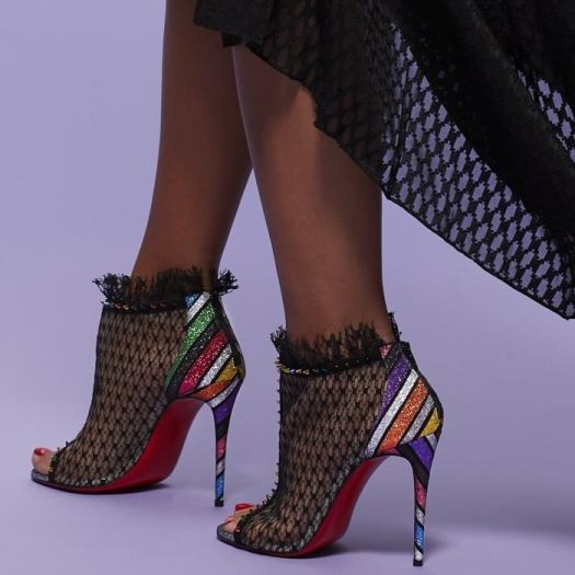 A sensual arch that follows through to a counter and 100mm slim stiletto heel both crafted in this season's Velukid Strippyglitter brings back the 1970's and disco nights