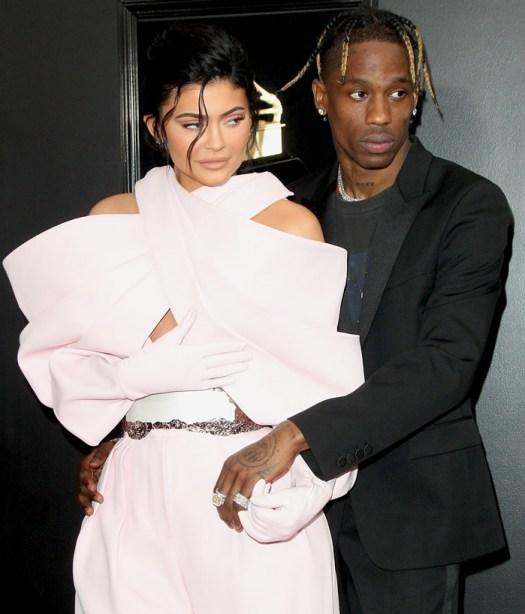 Kylie Jenner donned a pink bubblegum jumpsuit and Travis Scott a Saint Laurent blazer