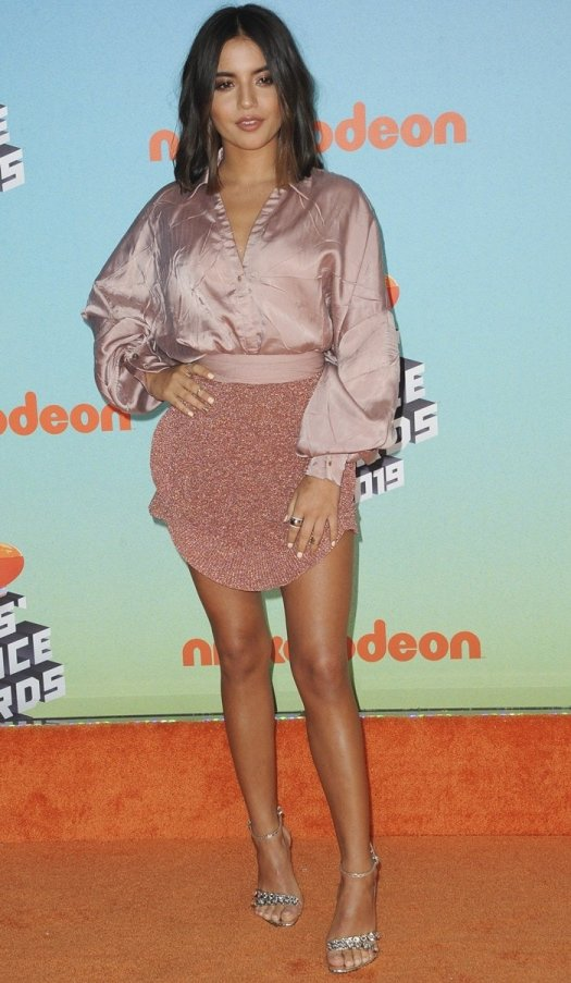 Isabela Moner flaunted her hot legs in a shimmery pink side ruffle mini skirt