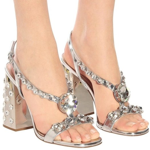 Dripping in opulent crystals, these sandals from Miu Miu indulge in a moment of grandeur glamour