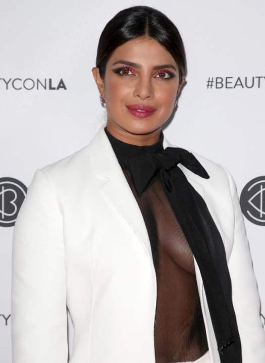 Priyanka Chopra's see-through shirt and bright pink and black eye makeup