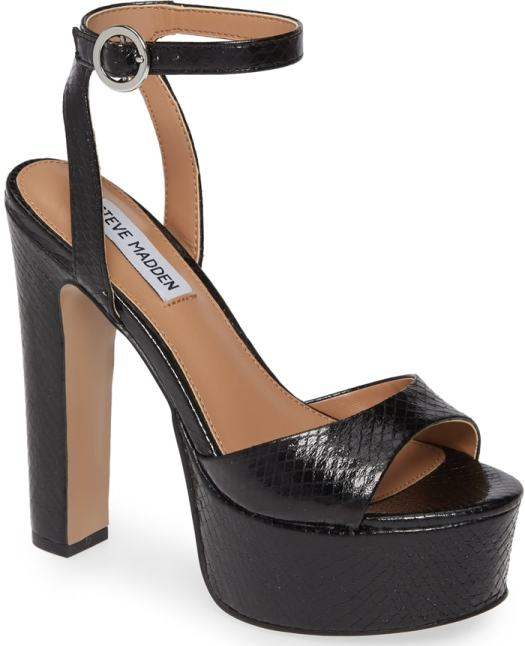 A lofty platform amplifies the retro appeal of this standout black ankle-strap sandal