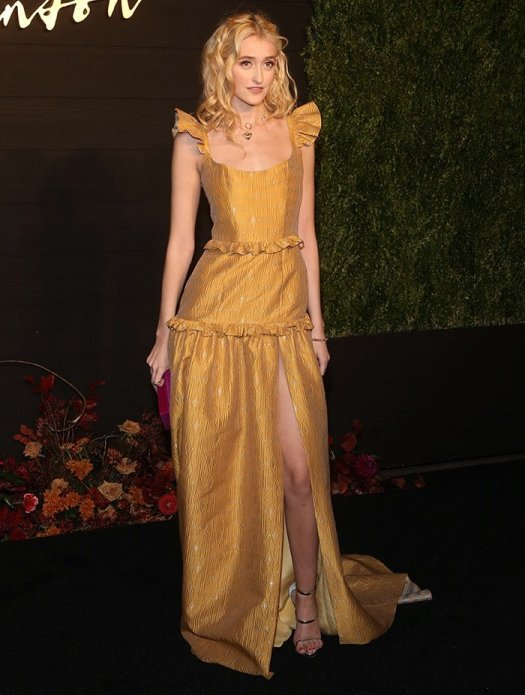 Gus Birney in Markarian spring 2019 gold gown at the premiere of Dickinson in New York City on October 17, 2019