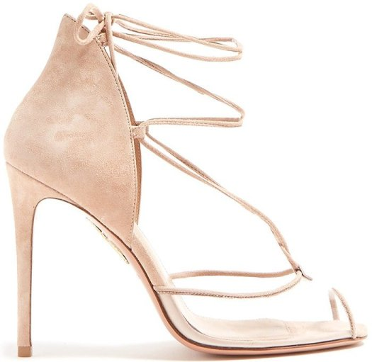 Designer Edgardo Osorio applies contemporary elements to classic silhouettes for Aquazzura's latest collection, as showcased by these light pink Magic sandals