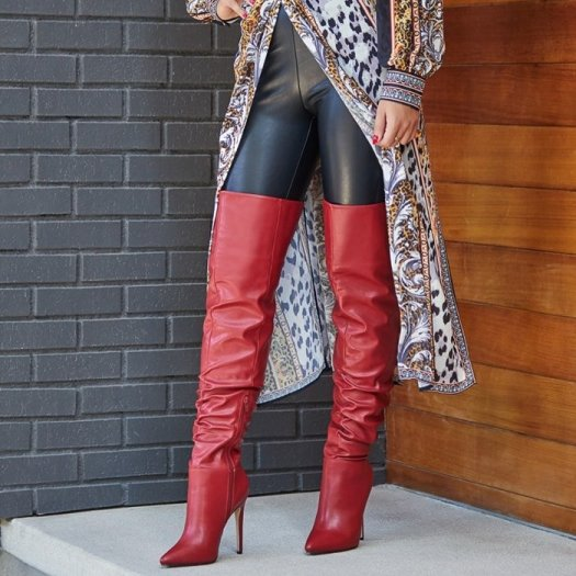 Slouchy thigh-high heeled boot with a pointed toe and stiletto heel